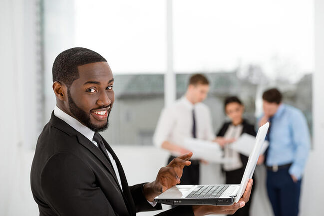 Smiling Business Man With Laptop Makes Personalized Rewards